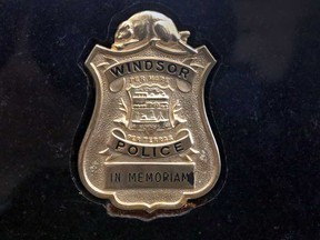 A memorial to Const. John Atkinson at Windsor police headquarters. Police say a similar memorial was stolen from the Chrysler Building at the University of Windsor on Aug. 3, 2018.