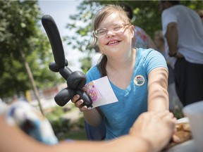 Kristen Shuster, 22, gets a temporary Windsor police tattoo from Const. Cealia Gagnon at the Bruce Awad Summer Program for Autism Services Open House at Mt. Carmel Elementary School on Thursday, Aug. 9, 2018.