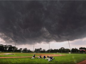Aug. 6 — Members of the Tecumseh Thunder baseball team are shown at the Cullen Stadium field at Mic Mac Park on Monday, August 6, 2018, as threatening storm clouds quickly rolled in.