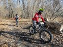 Mountain bikers using the trails in Black Oak Heritage Park in December 2017, prior to the city outlawing trail riding in the most sensitive areas of the park.