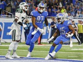 Detroit Lions wide receiver Golden Tate (15) scores on a 24-yard touchdown reception against the New York Jets during the second half of an NFL football game in Detroit, Monday, Sept. 10, 2018.