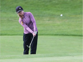Gold-medal winner Hailey Katona, of Tilbury, chips onto the green on the ninth hole on Thursday  at Ambassador's Golf Course during OFSSA Girls championship.