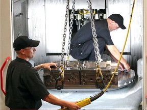 Cavalier Tool and Manufacturing Ltd. workers Jeremy Mateciuk, left, and Tony Copetrone are shown Sept. 26, 2018, mounting a mold cavity onto a Hermle 5-axis CNC high-speed machining centre.  Cavalier Tool and other companies open their doors to hundreds of local students on Oct. 5, 2018, for Manufacturing Day.