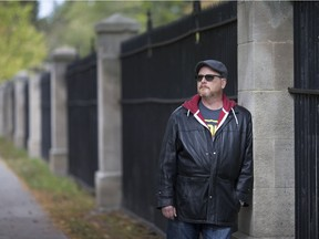 Ward 4 Coun. Chris Holt, a member of the Willistead Manor board of directors, is shown at Willistead Park, Oct. 19, 2018, next to a heritage fence in need of repairs.