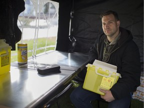 Brandon Bailey, a member of the Windsor Overdose Prevention Society, sits in a mock overdose prevention site outside Victoria Manor in downtown Windsor, Saturday, November 3, 2018.