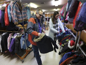 Warm all over. The Unemployed Help Centre's Coats for Kids program received over 300 coats on Dec. 13, 2018, from the annual coat drive by Windsor's Muslim community. Here, Russ Anderson, chairman of the organization and Heidi Benson, coordinator, hang up donated coats.