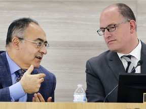 City of Windsor CAO Onorio Colucci, left, speaks to Mayor Drew Dilkens during a council meeting on Dec. 17, 2018.