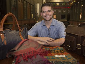 Dylan Verburg, a University of Windsor student, displays products he imported from India, such a various textiles, and buffalo leather handbags, before the start of Windsor Soup at the Walkerville Brewery, Sunday, November 25, 2018.  Verburg returned from India and started INpact Collective.