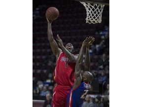 WINDSOR, ONT:. JANUARY 9, 2019 - Windsor's Juan Patillo takes a shot while Cape Breton's Olu Famutimi defends in NBLC action between the Windsor Express and the Cape Breton Highlanders at the WFCU Centre, Wednesday, January 9, 2019.