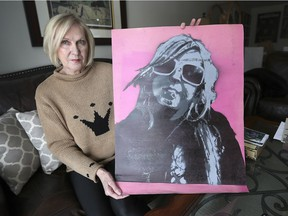 Judy Danford holds a self portrait painted by her daughter Victoria Hillier on Jan. 24, 2019 at her Kingsville home. Hillier committed suicide in December 2018 after years of mental health issues.