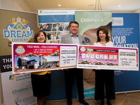 Leamington resident Mary Defrancisco (left) with John MacFarlane, president of the London Health Sciences Centre Foundation, and Heather Whyte, who won the Dream Lottery's 50/50 draw, on Jan. 10, 2019.