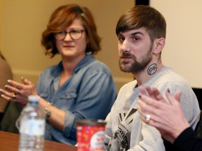 Human trafficking survivor Tamas Miko receives applause after sharing his story during a Human Trafficking Awareness Day roundtable discussion organized by Shelley Gilbert, left, co-ordinator social work services, Legal Assistance Windsor.  The discussion was held at Community Living Windsor on Enterprise Way Friday.