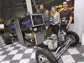 Gord Osborne, a transportation technology teacher at Kingsville District High School along with students Paige Roddy, left, Grace Vermeulen and Alec Tonkin pose with Dragula 2.0 on Tuesday, March 5, 2019, at the Canadian Transportation Museum in Kingsville. The purple coffin dragster is based on a car from the TV show Munsters. The car built by about 80 students under Osborne's guidance won two awards at the Detroit Autorama show.