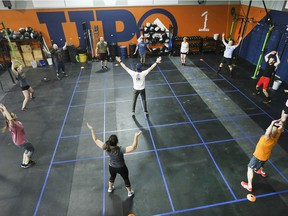 All Levels CrossFit Gym has teamed up with The Chasing Hazel Foundation to launch its inclusive crossfit classes. Brett Clarke, centre, leads a group during a work out on  March 19, 2019.