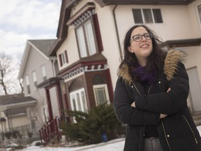 Sarah Morris, volunteer coordinator of Jane's Walk, stands in front of a row of homes on Louis Avenue that are included in the tour taking place in May, Wednesday, March 6,  2019.