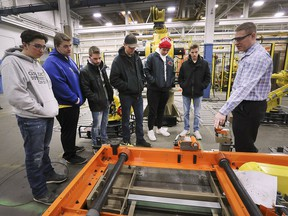 WINDSOR, ON. MARCH 5, 2019. --  Tom Harlow, a PLC manager with Valiant TMS in Windsor, ON. gives students from Essex High School a tour of the business on Tuesday, March 5, 2019. Valiant TMS was one of several local facility participating in Test Drive Day which connects students with skilled trades employers.