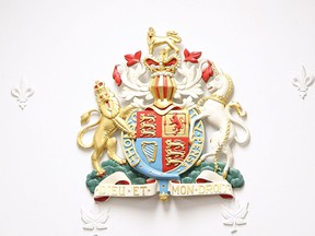 The Royal Coat of Arms from behind the judges' bench in a courtroom at the Superior Court of Justice in Windsor in April 2016.