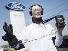 Windsor Star reporter, Taylor Campbell, tries on a drugged driving suit, created by Ford Canada, while at Rose City Ford, Wednesday, May 15,  2019.  The suit allows one to experience what it might be like while being high on drugs and how impaired you'd become.