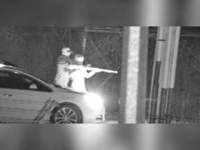 A surveillance camera image of the male and female suspect who practiced shooting a long gun on Lauzon Road in the early hours of May 4, 2019.
