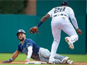 Niko Goodrum #28 of the Detroit Tigers tags out Kevin Kiermaier #39 of the Tampa Bay Rays attempting to steel second base in the sixth inning during a MLB game at Comerica Park on June 6, 2019 in Detroit, Michigan.