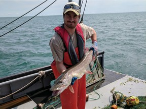 Jan-Michael Hessenauer, Ph.D. Fisheries Research Biologist Lake St. Clair Fisheries Research Station Michigan Department of Natural Resources. Hessenauer is seen with a muskie captured as part of the Michigan DNR trawl survey in Lake St. Clair in August 2016.