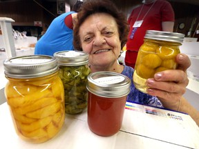 Julie Dunkley of Harrow poses with a variety of homegrown produce at 165th Harrow Fair which opens Thursday, August 29th.