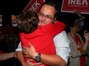 Liberal challenger Irek Kusmierczyk embraces a supporter at his victory party after winning the MP seat for Windsor-Tecumseh on Oct. 21, 2019.