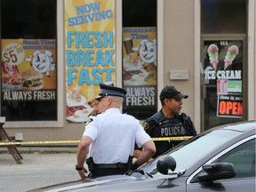Leamington OPP are seen outside the Break Time Corner Restaurant in Leamington on June 29, 2017, during an investigation into the death of Du Weiqiong the day before. Her husband, Cheng Sun is on trial in Superior Court on a charge of second-degree murder.