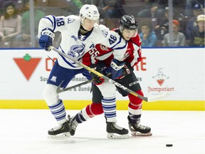Windsor Spitfires' rookie centre Wyatt Johnston, seen at right in action against Mississauga Steelheads' Thomas Harley, was selected by Hockey Canada to play at the World Under-17 Hockey Challenge.