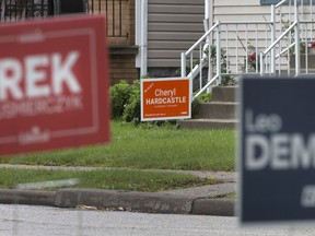 Anybody's to win? Lawn signs for Windsor-Tecumseh candidates from the Liberal, Conservative and NDP parties are shown Oct. 3, 2019, on Marion Avenue. A new poll suggests all three major parties are in play in the local riding. Canadians go to the polls on Oct. 21.