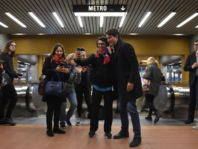 Prime Minister Justin Trudeau greets commuters at a metro station in Montreal, Tuesday, Oct. 22, 2019.