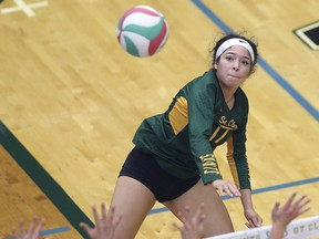 Freshman outside hitter Baylee Mailloux, who is a St. Anne high school product, spikes for the St. Clair Saints during Saturday's three-set sweep over  Redeemer Royals in OCAA women's volleyball play at the SportsPlex.