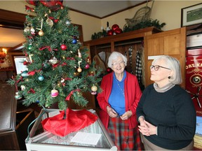 Kingsville, Ontario Dec. 8, 2019. Author Jane Buttery, left, and Jill Nicholson, Acting Education and Public Programs Co-ordinator, admire century old Christmas tree ornaments during Sunday's Jack Miner Migratory Bird Sanctuary Country Christmas event.  Dozens of area residents and visitors toured the original home and buildings and about 20 took a hike along Jack Miner Trail System.