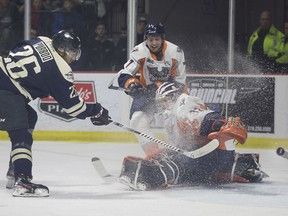 Windsor Spitfires forward Cole Purboo nets the first goal of the game on Tuesday as he puts one past Firebirds' goalie Anthony Popovic, in OHL action at the WFCU Centre.