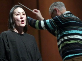 Teiya Kasahara performs the part of Cio-Cio San during Windsor Symphony Orchestra's rehearsal of Puccini's Madama Butterfly at Capitol Theatre Monday. Behind, Maestro Robert Franz conducts.