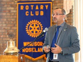Dr. Wajid Ahmed, medical officer of health, speaks about overdose related morbidity and morality in Windsor-Essex durng a visit to Rotary Windsor-Roseland luncheon at Fogolar Furlan Club Tuesday. .