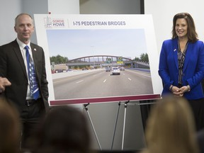 Bryce Phillips, left, CEO, Windsor-Detroit Bridge Authority, and Gretchen Whitmer, Governor of Michigan, pose next to the selected designs for the Michigan interchange pedestrian bridges, during a press conference at the Gordie Howe International Bridge Southwest Detroit community office, Thursday, January 9, 2020.