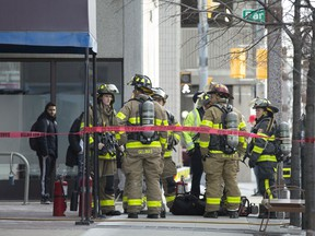 Fire crews work at the scene of a high rise fire at 380 Pelissier St., Wednesday, January 22, 2020.