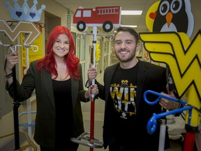 Iain and Chantelle, of the Fight Like Mason Foundation, are pictured with several IV poles, dubbed Mason's Power Poles, that were donated to Erie Shores Healthcare, Monday, January 20, 2020.