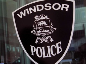 The Windsor Police Service insignia on the public door of the downtown headquarters building.