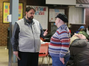 Downtown Mission Executive Director Ron Dunn, left, speaks to a mission visitor about changes to operating hours Wednesday Feb. 5, 2020.
