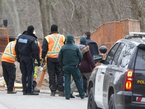 OPP officers and officials with Parks Canada work at the scene where skeletal remains were discovered at a construction site at Point Pelee National Park, Feb. 5, 2020.