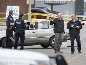 Windsor police are shown investigating at the scene of an assault with a motor vehicle that occurred at the Lube King on Tecumseh Road East between Westcott Road and Aubin Road on Monday, April 6, 2020.