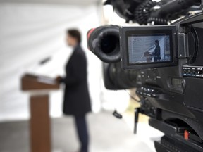 Prime Minister Justin Trudeau is seen on the screen of a broadcast camera as he speaks during his daily press conference on the COVID-19 pandemic, outside his residence at Rideau Cottage in Ottawa, Friday, April 24, 2020.