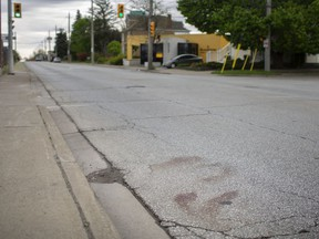 The scene of an accident where a cyclist was struck by a motor vehicle at the intersection of Walker Road and Richmond Street, Sunday, May 17, 2020.  The incident occurred the previous evening and the cyclist remains in serious condition.