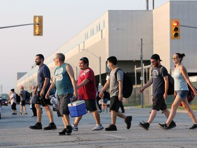 Into the morning light, autoworkers leave FCA's Windsor Assembly Plant following the final third shift at 7 a.m. Friday. Moving forward the plant, which produces Chrysler Pacificas and Dodge Grand Caravans will operate on two shifts.
