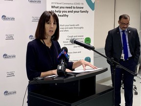 Theresa Marentette, CEO of the Windsor-Essex County Health Unit, addresses media on March 24, 2020, as medical officer of health Dr. Wajid Ahmed looks on.