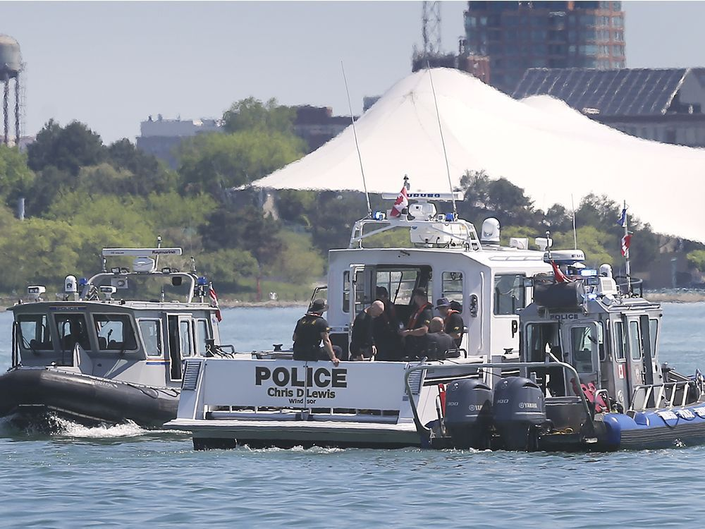 Marine units from the RCMP, left, OPP, centre, and Windsor Police Service are shown on the Detroit River near downtown Windsor on May 26, 2020, during a search for a person who jumped in the river.