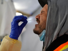 Provincial health workers perform coronavirus disease nasal swab tests on Raymond Robins of the remote First Nation community of Gull Bay, Ontario April 27, 2020.