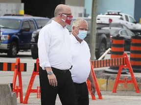Windsor Mayor Drew Dilkens, left, and Premier Doug Ford are shown at the City of Windsor public works yard on Crawford Avenue on Thursday, August 13, 2020 where a COVID-19-centred news conference was held.